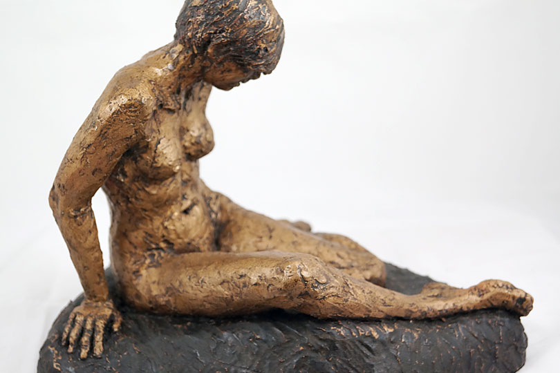 Sculpture of Alice looking down