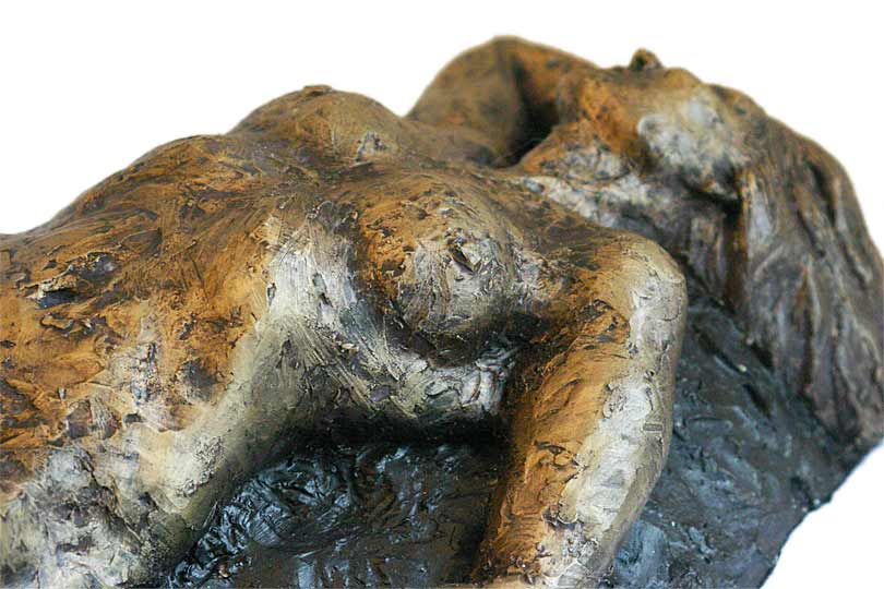 small figure of Judith reclining. Fired clay